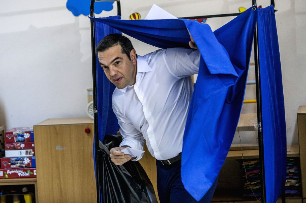ATHENS, July 7, 2019 (Xinhua) -- Greek Prime Minister Alexis Tsipras prepares to cast his vote at a polling station in Athens, Greece, July 7, 2019. Greek voters started casting their ballots on Sunday in the first parliamentary elections since the c - Alexis Tsipras