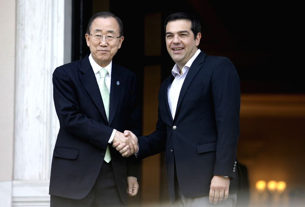 ATHENS, June 18, 2016 - Visiting UN Secretary-General Ban Ki-moon (L) shakes hands with Greek Prime Minister Alexis Tsipras in Athens, capital of Greece, on June 18, 2016. UN Secretary-General Ban ... - Alexis Tsipras