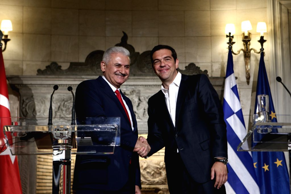 ATHENS, June 19, 2017 - Greek Prime Minister Alexis Tsipras (R) shakes hands with Turkish Prime Minister Binali Yildirim during a joint press briefing in Athens, Greece on June 19, 2017. Greece's ... - Alexis Tsipras