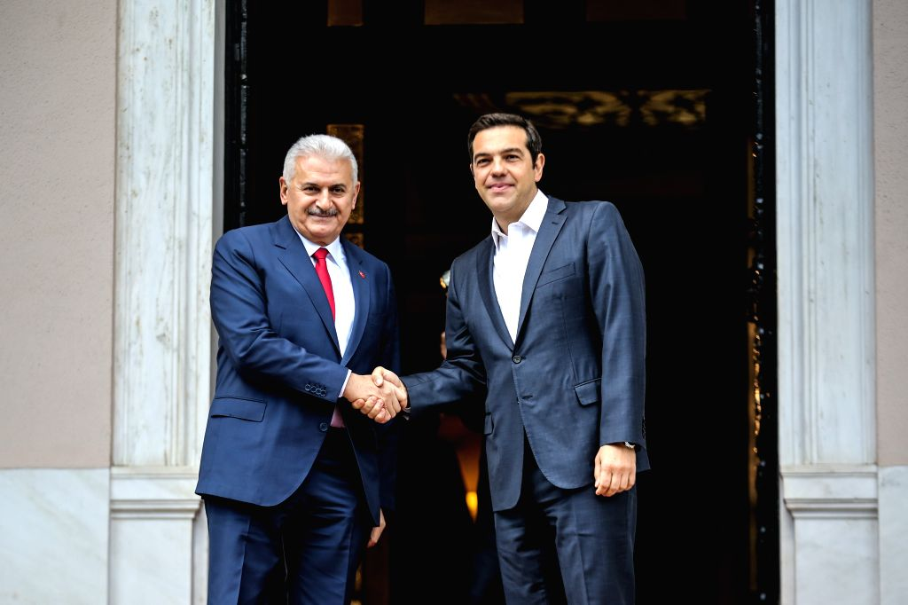 ATHENS, June 19, 2017 - Greek Prime Minister Alexis Tsipras (R) welcomes Turkish Prime Minister Binali Yildirim in Athens, Greece on June 19, 2017. Greece's political leaders and Turkish Prime ... - Alexis Tsipras