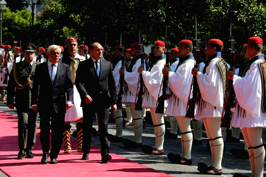 ATHENS, June 24, 2017 - Greek President Prokopis Pavlopoulos (front L) and his Bulgarian counterpart Rumen Radev (front R) inspect a guard of honour at a welcome ceremony outside the presidential ...