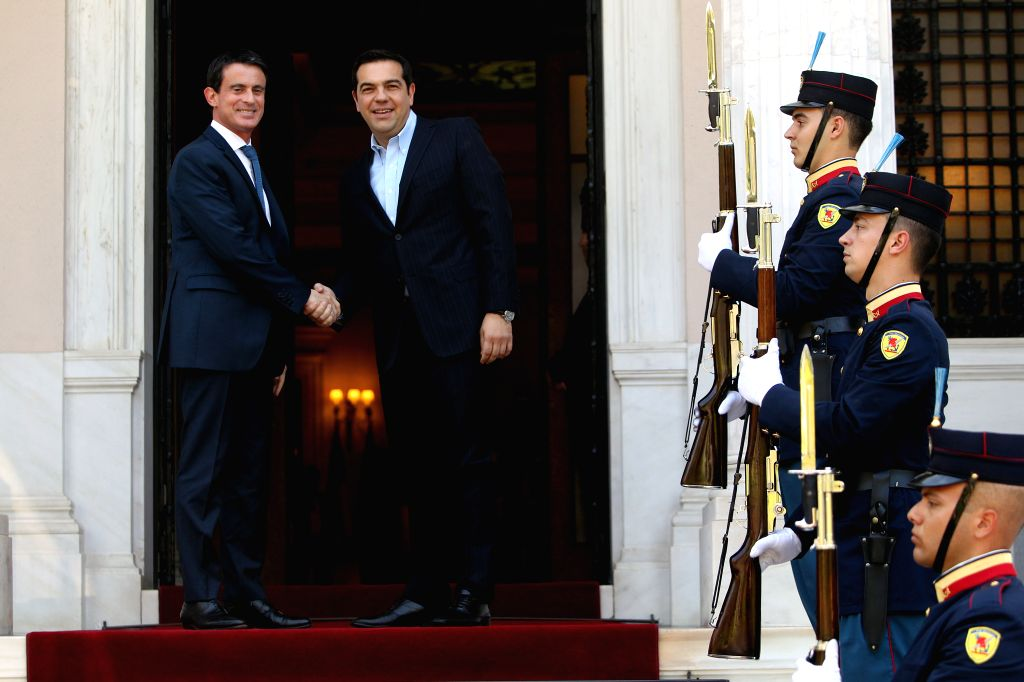 ATHENS, June 3, 2016 - Greek Prime Minister Alexis Tsipras (2nd L) welcomes his French counterpart Manuel Valls (1st L) at the Maximos Mansion in Athens, Greece, June 3, 2016. - Alexis Tsipras