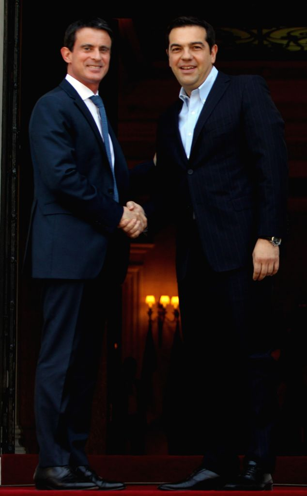 ATHENS, June 3, 2016 - Greek Prime Minister Alexis Tsipras (R) welcomes his French counterpart Manuel Valls at the Maximos Mansion in Athens, Greece, June 3, 2016. - Alexis Tsipras