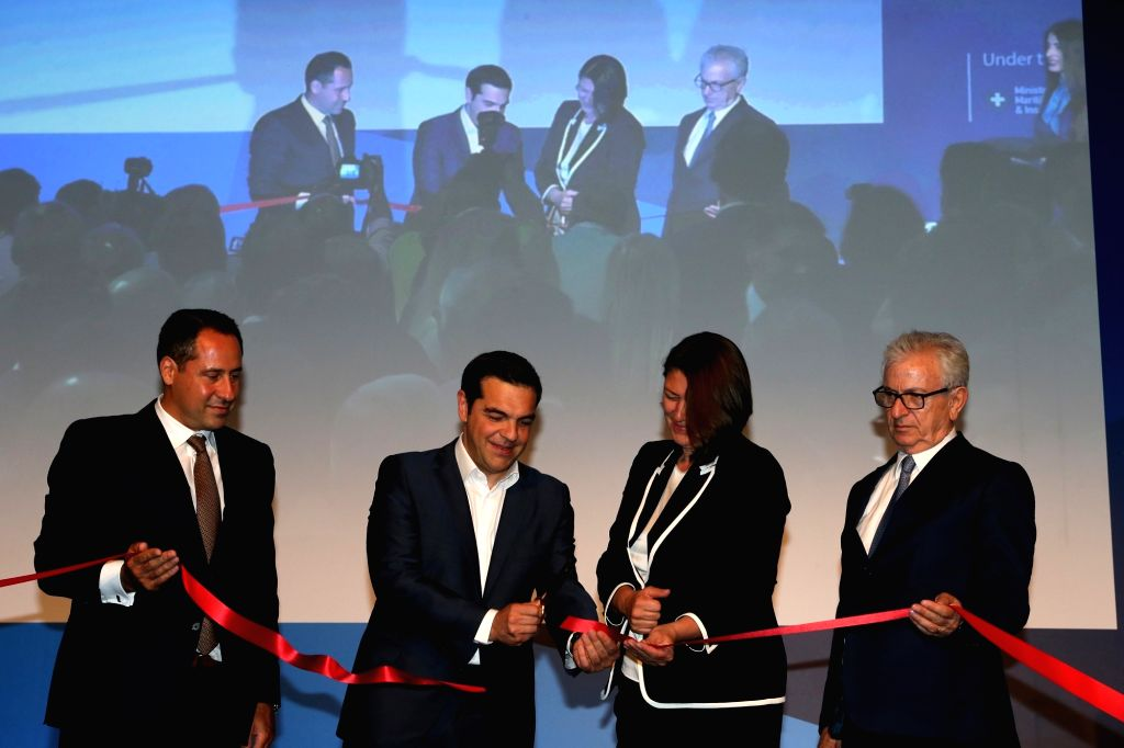 ATHENS, June 4, 2018 - Greek Prime Minister Alexis Tsipras (2nd L) cuts a ribbon to kick off the International Shipping Exhibition of Posidonia in Athens, Greece, on June 4, 2018. Greek Prime ... - Alexis Tsipras