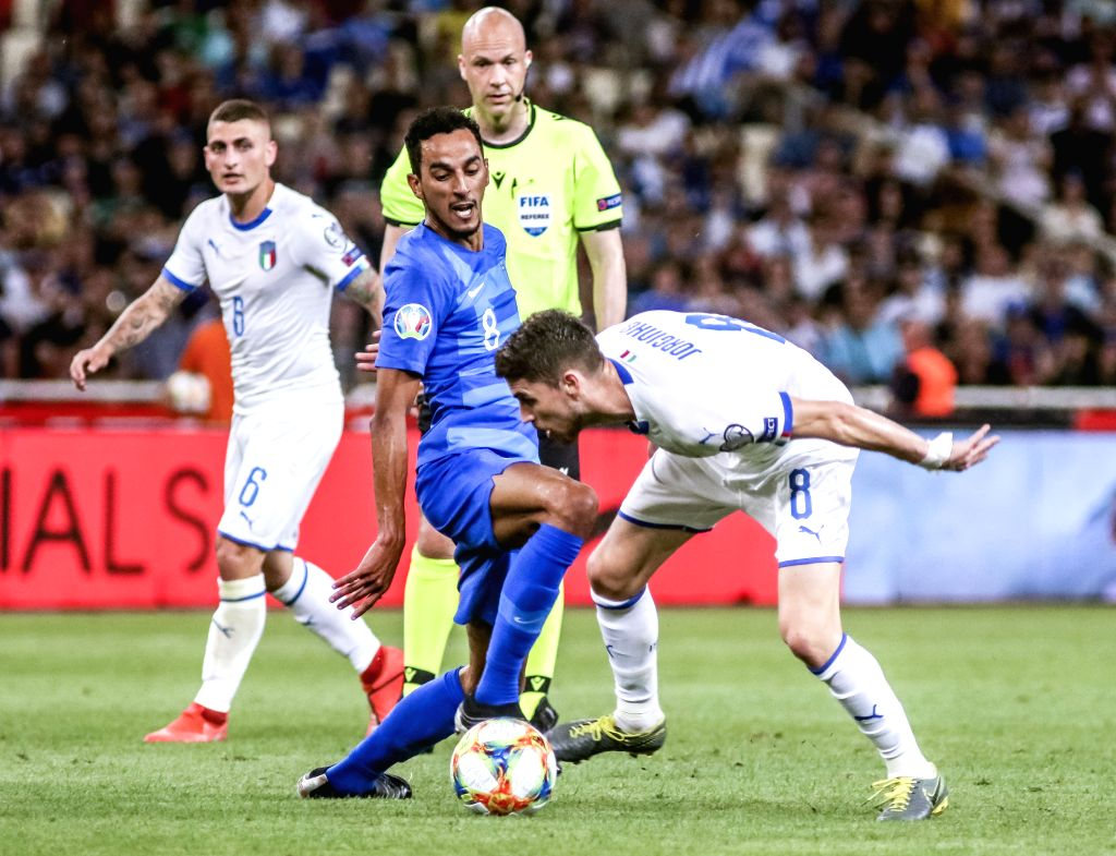 ATHENS, June 9, 2019 - Greece's Carlos Zeca (front L) vies with Italy's Jorginho (front R) the UEFA Euro 2020 Group J qualifier soccer match in Athens, Greece, June 8, 2019.