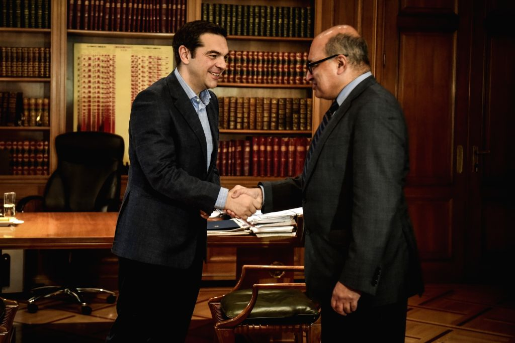 ATHENS, March 27, 2018 - Greek Prime Minister Alexis Tsipras (L) shakes hands with European Bank for Reconstruction and Development (EBRD) President Suma Chakrabarti during their meeting in Athens, ... - Alexis Tsipras
