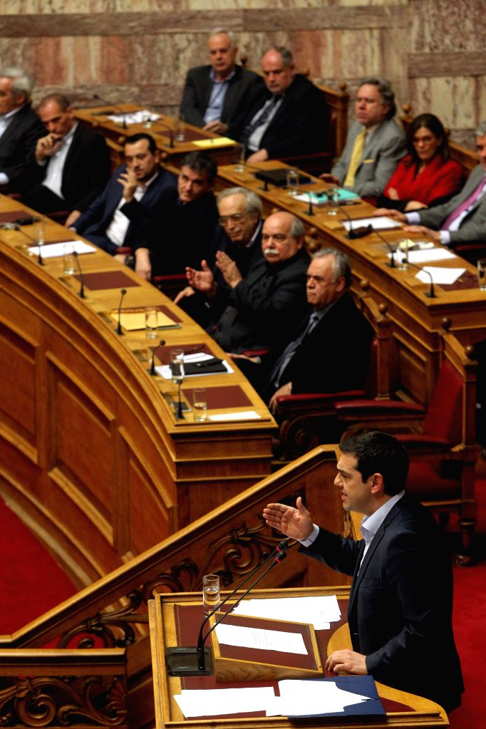 Greek Prime Minister Alexis Tsipras addresses a parliament session in Athens, Greece, on March 30, 2015. Greek Prime Minister Alexis Tsipras called on opposition ... - Alexis Tsipras