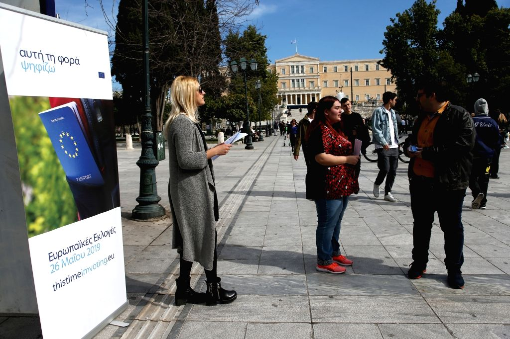 ATHENS, March 5, 2019 - Greek volunteers hand out leaflets which contain voting information about the forthcoming European Parliament elections at Syntagma square, in Athens, Greece, on March 5, ...