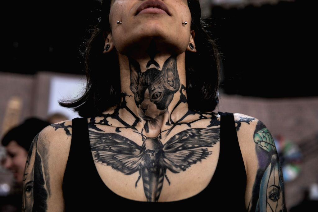 ATHENS, May 12, 2019 - A participant shows off her tattoo during the 13th International Athens Tattoo Convention in Athens, Greece, on May 11, 2019.