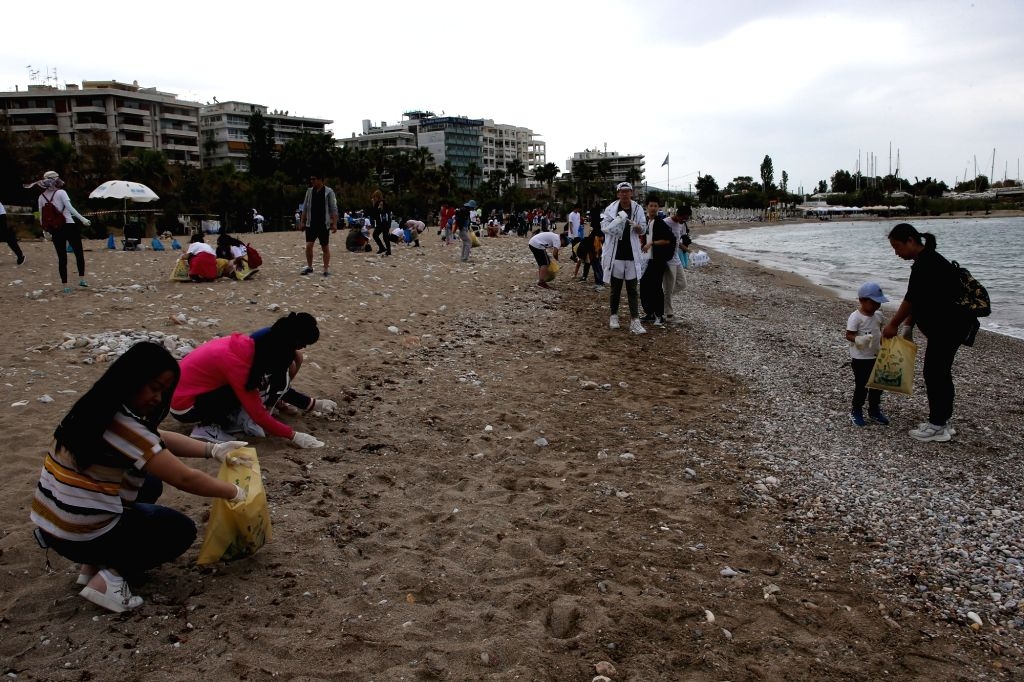 ATHENS, May 19, 2019 - Volunteers clean up Palaio Faliro beach in southern Athens, Greece, on May 19, 2019. Chinese in Greece won the warm praise of Athenians on Sunday for taking the initiative to ...