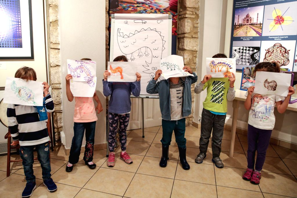 ATHENS, May 28, 2017 - Children show their paintings of Chinese dragons at an art workshop at the Museum Herakleidon in Athens, capital of Greece, on May 28, 2017. Two art workshops brought Greek ...