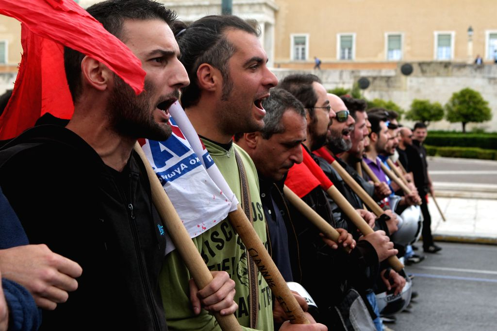 ATHENS, May 6, 2016 - Protesters from communist-affiliated union PAME chant slogans during a demonstration in front of the Athens Library, in Athens, Greece, on May 6, 2016. Greece's labour unions ...
