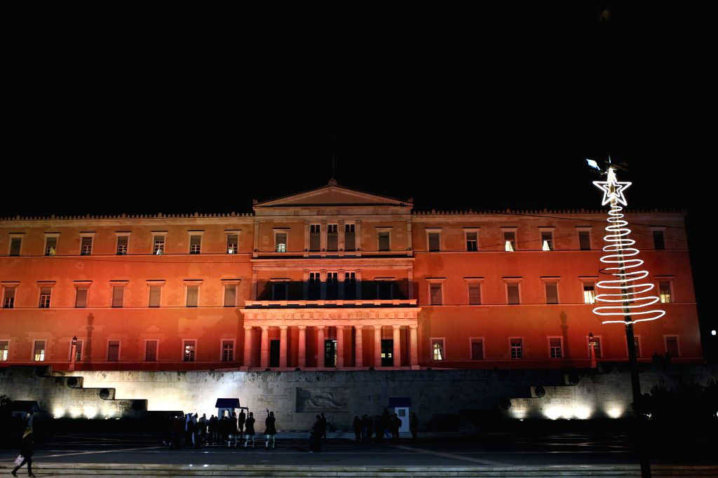 ATHENS, Nov. 25, 2016 - The building of Greek Parliament is lit up in pink in support of the International Day for the Elimination of Violence against Women, in Athens, capital of Greece, on Nov. 25, ...