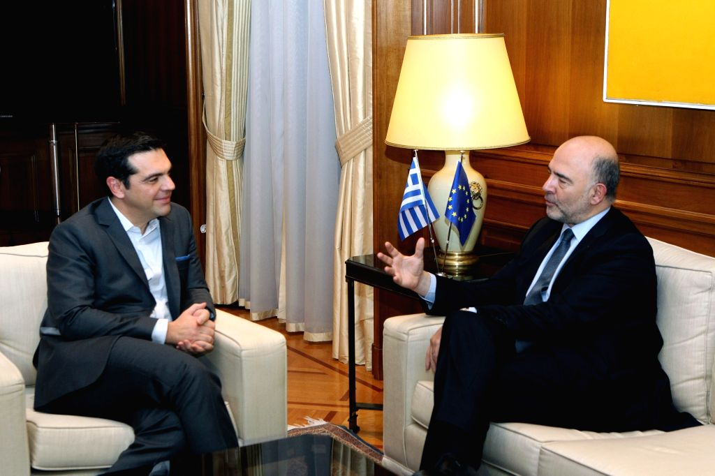 ATHENS, Nov. 28, 2016 - Greek Prime Minister Alexis Tsipras (L) and European commissioner for economic and financial affairs Pierre Moscovici talk during their meeting at Maximos Mansion in Athens, ... - Alexis Tsipras