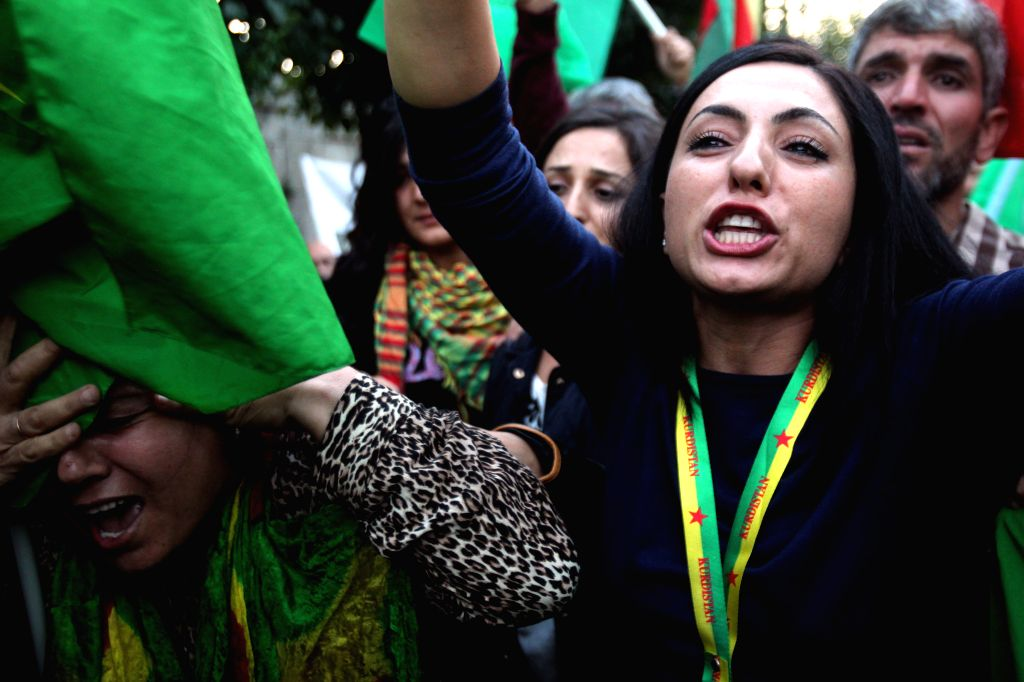 ATHENS, Oct. 13, 2014 (Xinhua) -- Kurdish women living in Greece protest during a pro-Kurd demonstration against attacks launched by Islamic State militants targeting the Syrian city of Kobane and the lack of action by the Turkish government in centr