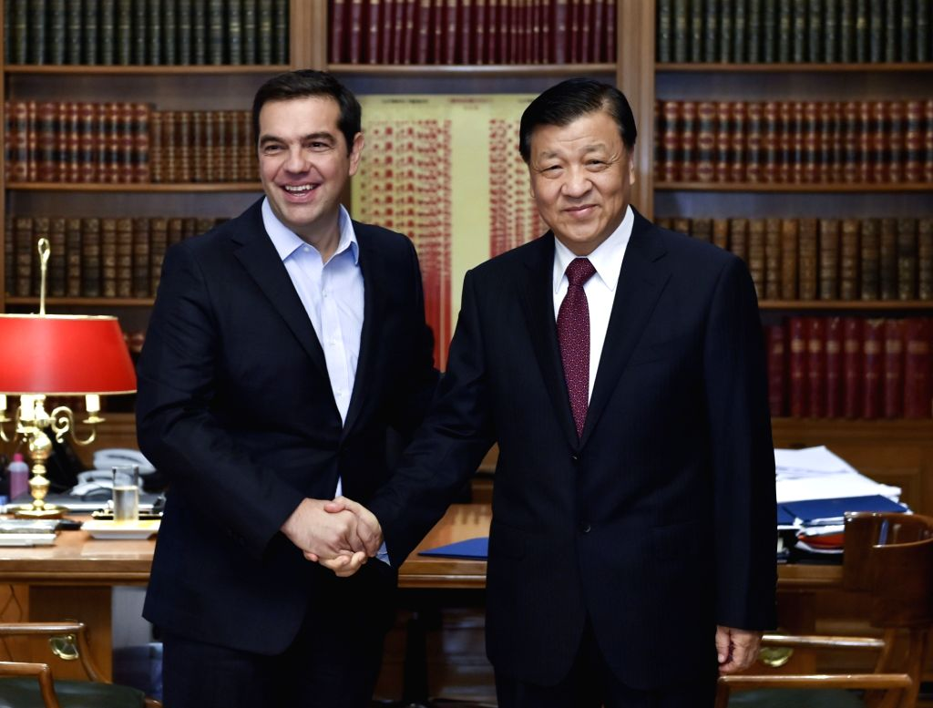 ATHENS, Oct. 4, 2016 - Liu Yunshan (R), a member of the Standing Committee of the Political Bureau of the Central Committee of the Communist Party of China, meets with Greek Prime Minister and leader ...