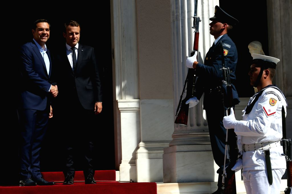 ATHENS, Sep. 7, 2017 - Greek Prime Minister Alexis Tsipras (1st L) shakes hands with French President Emmanuel Macron (2nd L)in Athens, Greece, Sept. 7, 2017. France will continue to stand by ... - Alexis Tsipras