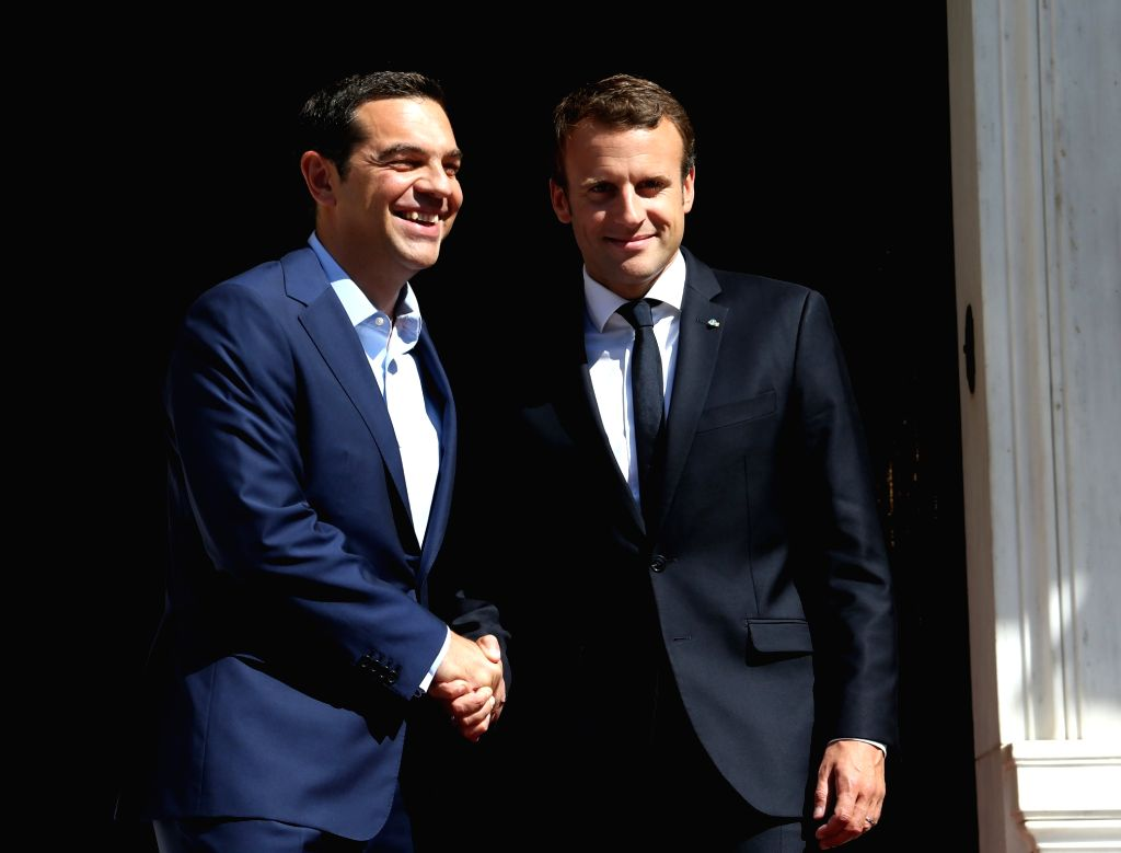 ATHENS, Sep. 7, 2017 - Greek Prime Minister Alexis Tsipras (L) shakes hands with French President Emmanuel Macron in Athens, Greece, Sept. 7, 2017. France will continue to stand by Greece's side in ... - Alexis Tsipras