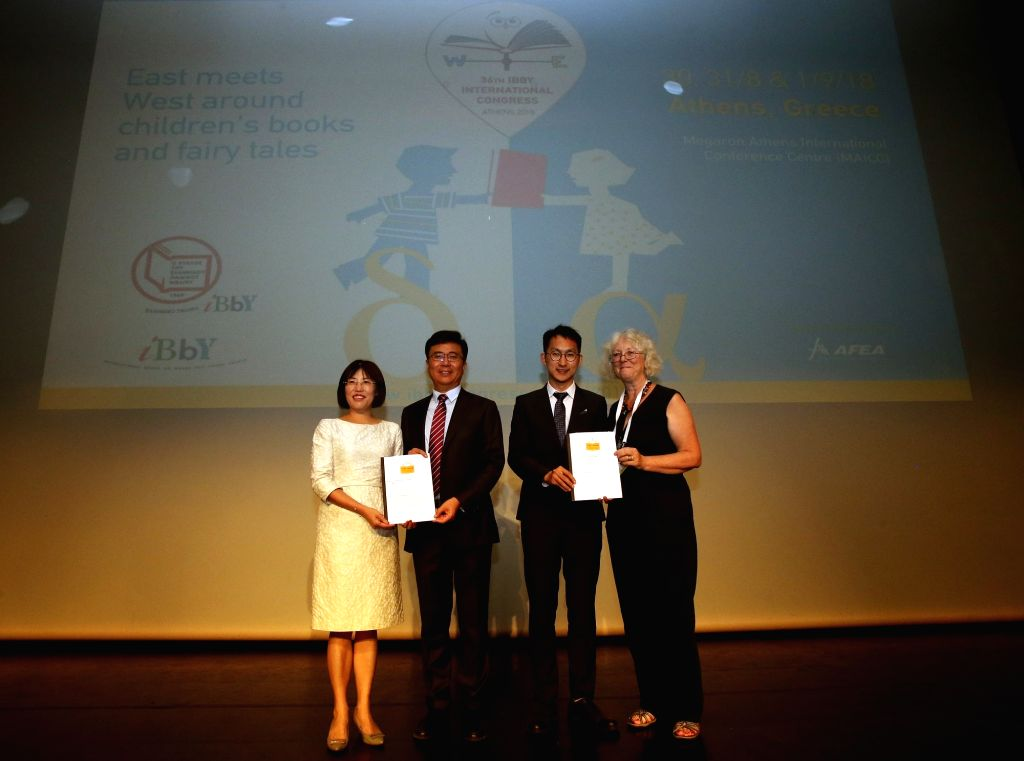 ATHENS, Sept. 1, 2018 - Newly elected President of International Board on Books for Young People (IBBY) Zhang Mingzhou (2nd L) and President of iRead Foundation Li Wen (1st L) pose for photos after ...