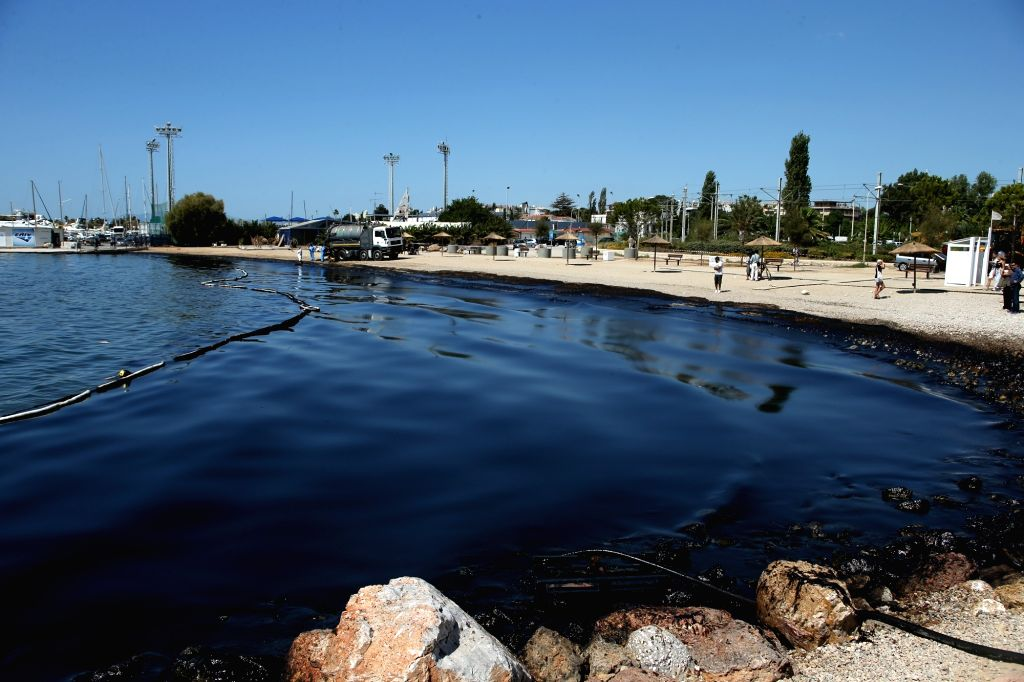 ATHENS, Sept. 14, 2017 - Specialized crew take part in an operation to clean the oil spill from the shores of Glyfada, a southeast suburb of Athens, capital of Greece, on Sept. 14, 2017. A major ... - Panagiotis Kouroumblis