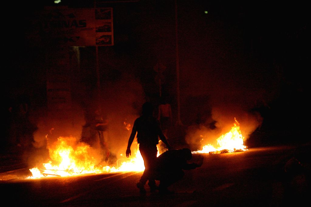 ATHENS, Sept. 17, 2016 - Protesters clash with anti-riots police during an anti-fascist rally at Keratsini suburb, in Athens, Sept. 17, 2016. Thousands of Greeks took to the streets of Piraeus on ...