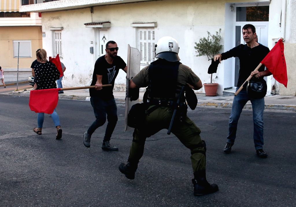 ATHENS, Sept. 18, 2017 - Protestors clash with anti-riot police during a rally at Piraeus near the capital Athens, Greece on Sept. 18, 2017. The rally was organized to mark the fourth anniversary of ...