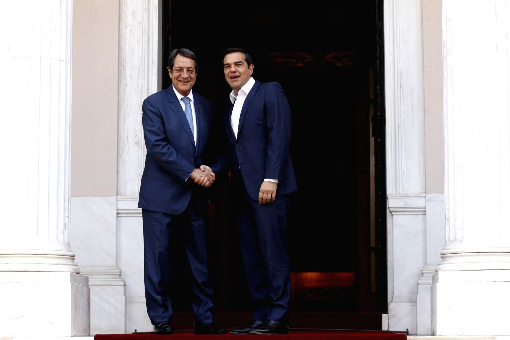 ATHENS, Sept. 18, 2018 - Greek Prime Minister Alexis Tsipras (R) welcomes Cyprus President Nicos Anastasiades at the Prime Minister's Office in Athens, Greece, on Sept. 17, 2018. Greek Prime Minister ... - Alexis Tsipras