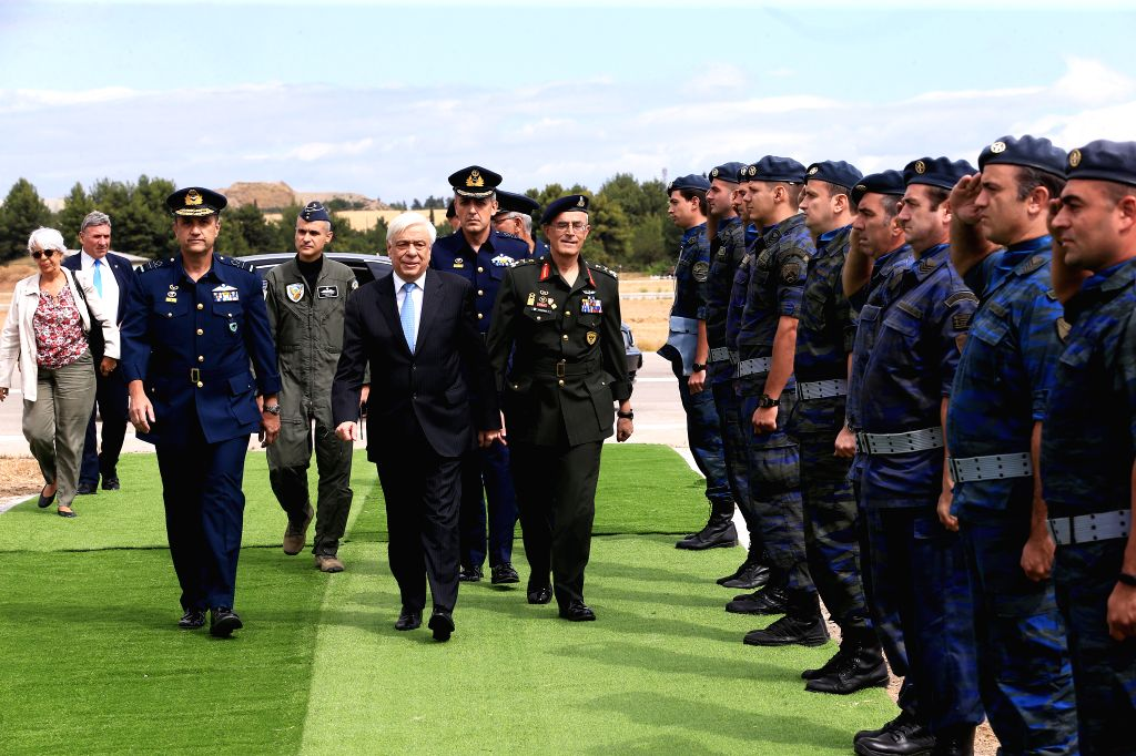 ATHENS, Sept. 21, 2019 - Greek President Prokopis Pavlopoulos (C, front) arrives at the Tanagra Air Base, north of Athens, Greece, on Sept. 21, 2019. Greece's largest air show, the Athens Flying Week ...