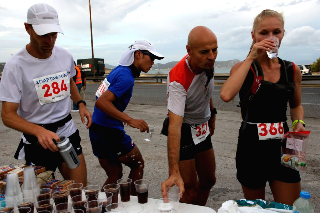 ATHENS, Sept. 29, 2017 - Athletes get supplies during the 35th edition of the annual ultra-marathon race Spartathlon from Athens to Sparta, in Greece, Sept. 29, 2017.