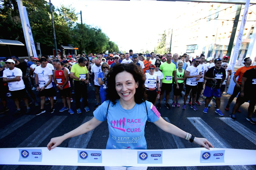 ATHENS, Sept. 29, 2019 - A runner of the 11th Greece Race for the Cure poses at the starting line of the race in Athens, Greece, Sept. 29, 2019. Greece Race for the Cure is a running event against ...