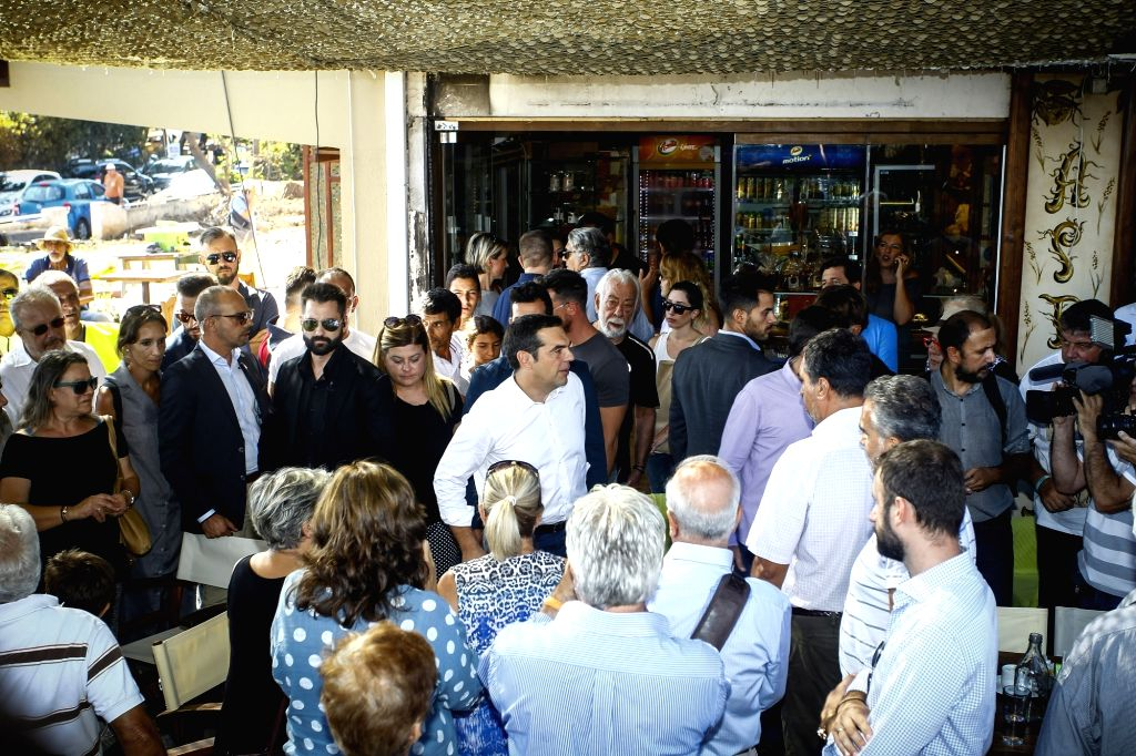 ATHENS, Sept. 5, 2018 - Greek Prime Minister Alexis Tsipras (C) meets with residents of Mati, Greece, on Sept. 4, 2018. The destructive July 23 wildfire swept through this seaside resort, 30 ... - Alexis Tsipras