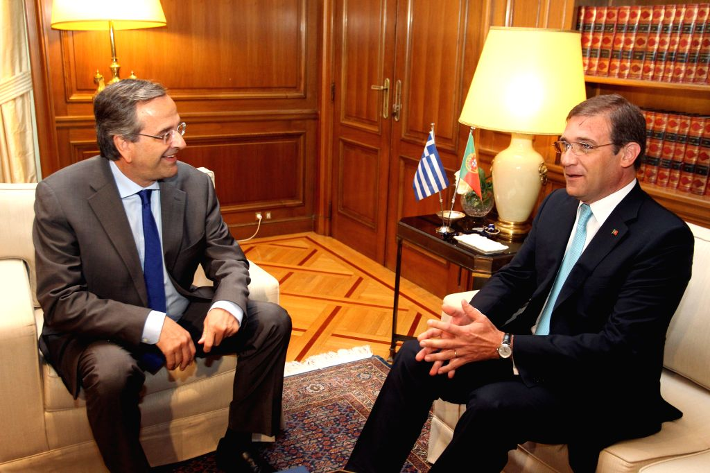 Greek Prime Minister Antonis Samaras (L) speaks with his Portuguese counterpart Pedro Passos Coelho at the Maximos Mansion in Athens, Greece, on Sept. 9, 2014. Coelho - Antonis Samaras