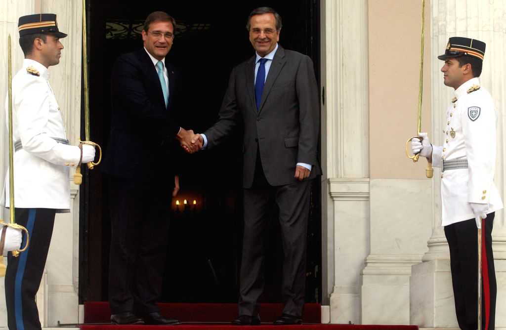 Greek Prime Minister Antonis Samaras (R) poses with his Portuguese counterpart Pedro Passos Coelho for photographers at the Maximos Mansion in Athens, Greece, on ... - Antonis Samaras