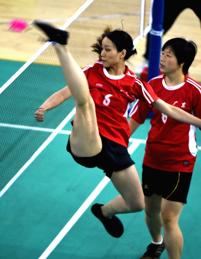 Athlete Li Baoyi (L) from south China's Guangdong Province kicks the shuttle-cock during the final of women's shuttle-cock kicking event of the 10th National ...