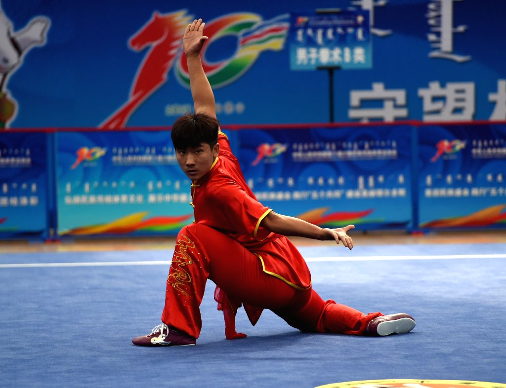 Athlete Zhang Hailin from northeast China's Jilin Province competes in a match of the martial arts during the 10th National Traditional Games of Ethnic Minorities of ...