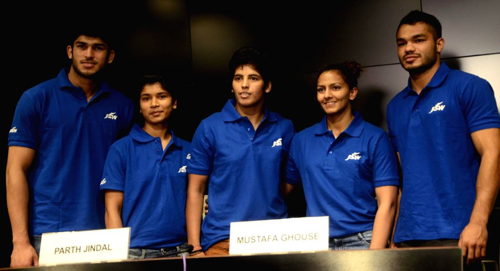 Athletes Avtar Singh (judoka), Zareen Nikhat (boxer), Garima Chaudhary (judoka), Geeta Phogat (wrestler) and Vikas Krishan Yadav (Boxer) during a press conference in Mumbai on July 17, 2014. - Avtar Singh, Garima Chaudhary and Vikas Krishan Yadav