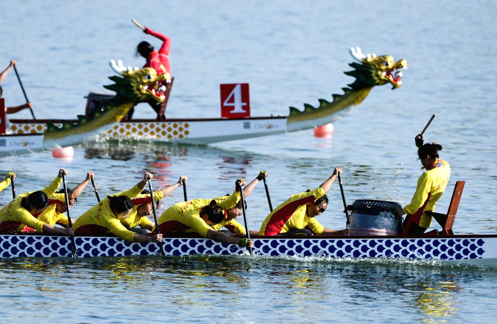 Athletes compete in a women's 800-meters match of the Dragon Boat Racing event during the 10th National Traditional Games of Ethnic Minorities of China in Ordos, north ...