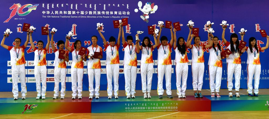 Athletes from north China's Inner Mongolia Autonomous Region wave on the awarding ceremony of women's Pearl Ball event during the 10th National Traditional Games of ...