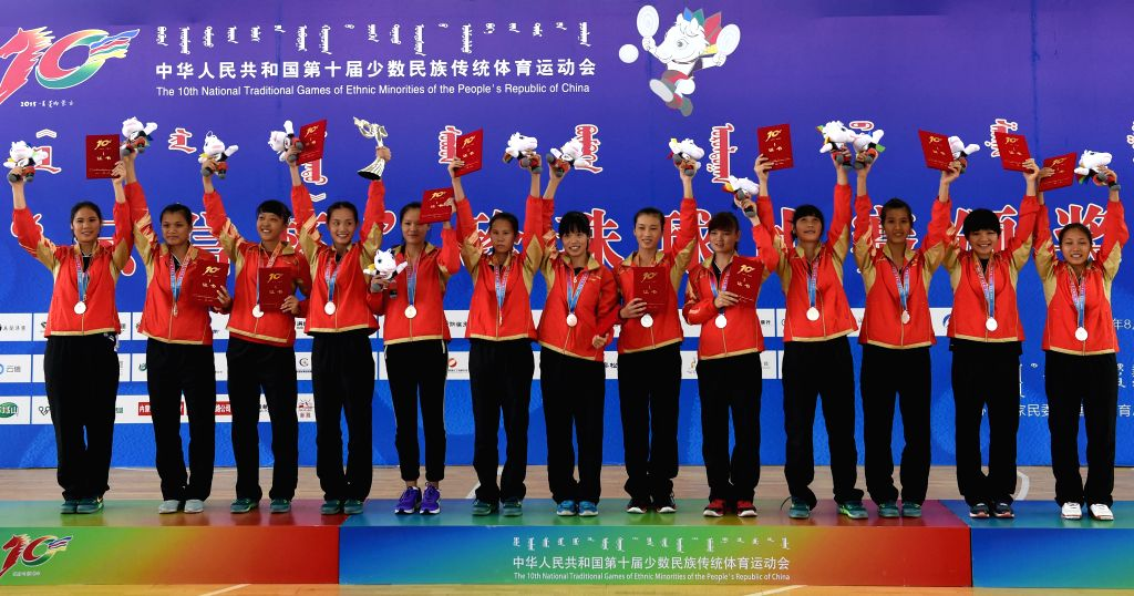 Athletes from south China's Guangxi Province wave on the awarding ceremony of women's Pearl Ball event during the 10th National Traditional Games of Ethnic Minorities ...