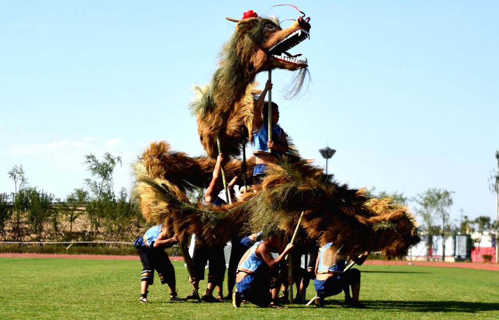 Athletes from southwest China's Guizhou Province perform a kind of original dragon dance during the 10th National Traditional Games of Ethnic Minorities of China in ...