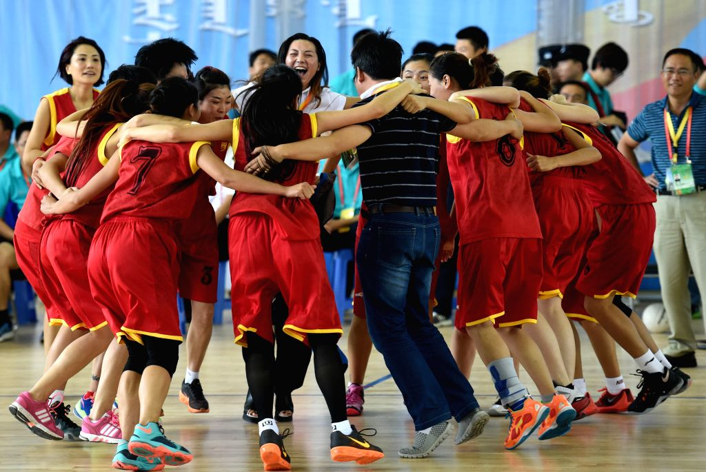 Athletes from southwest China's Sichuan Province celebrate after the women's Pearl Ball final during the 10th National Traditional Games of Ethnic Minorities of China ...