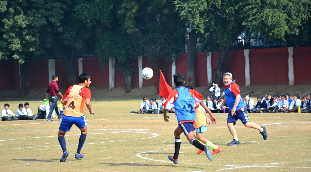 Athletes from Special Olympics Bharat play a football with the diplomats from Latin American countries during a match organised on International Day of Disabled Persons in New Delhi, on ...