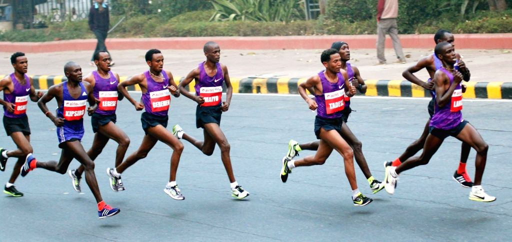 Athletes participate in Airtel Delhi Half Marathon 2015 at India Gate in New Delhi, on Nov 29, 2015.