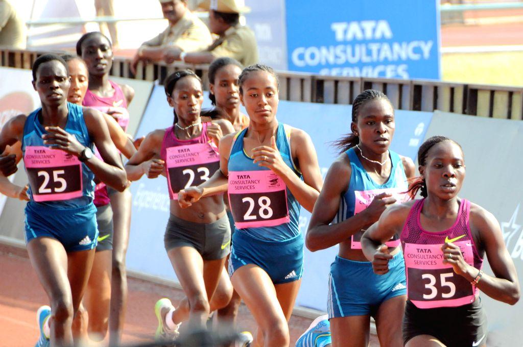 Athletes participate TCS World 10K Bangalore' at Kanteerava Stadium in Bangalore on May 18, 2014.