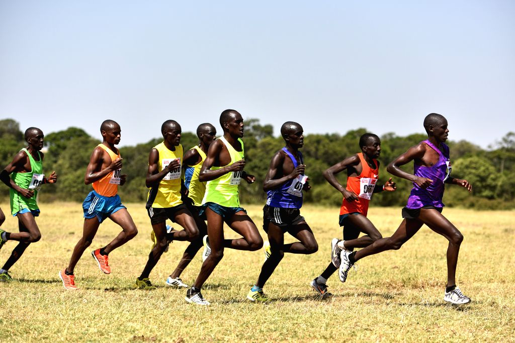Athletes run during the Masai Mara Marathon in Masai Mara Game Reserve, Kenya, Aug. 15, 2015.  Kenya held its 7th Masai Mara Marathon which is an event for ...