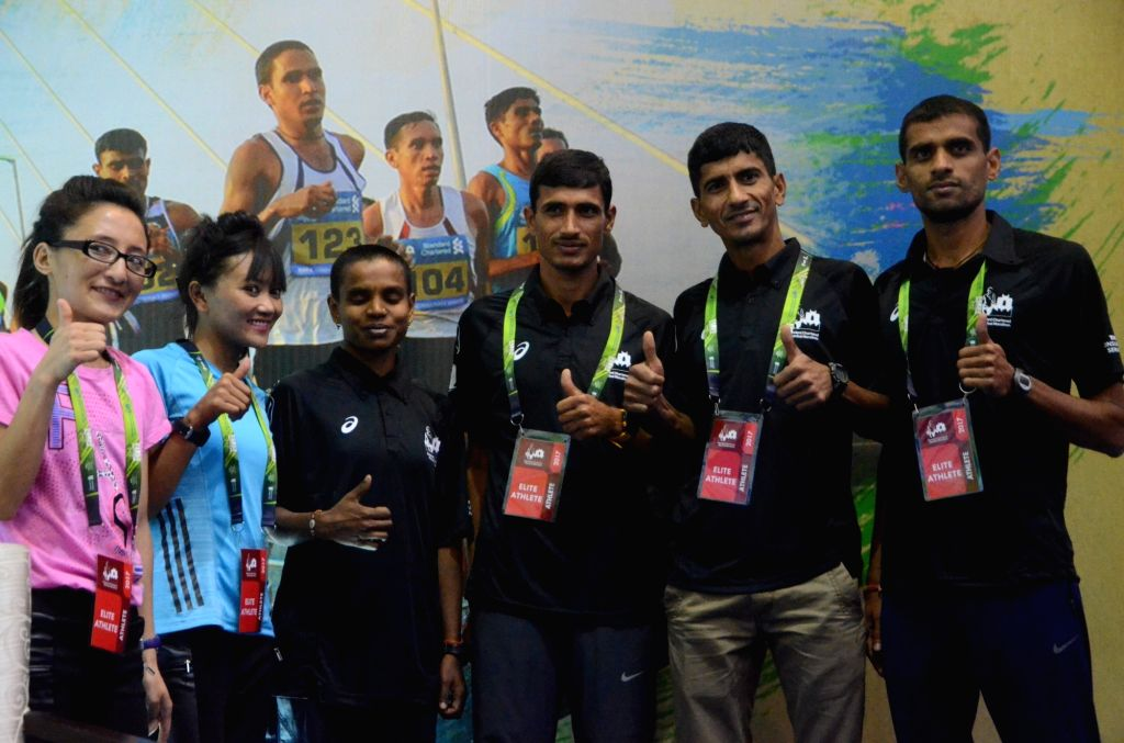Athletes Tsetan Dolkar, Jigmet Dolma, Jyoti Gawate, Kheta Ram, Elam Singh and Md Yunus (L-R) at Mumbai Marathon press conference in Mumbai, on Jan 13, 2017. - Singh