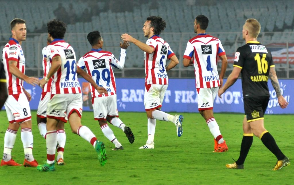ATK players celebrate a goal during an ISL match between ATK and Kerala Blasters FC at Salt Lake Stadium in Kolkata on Feb 8, 2018.
