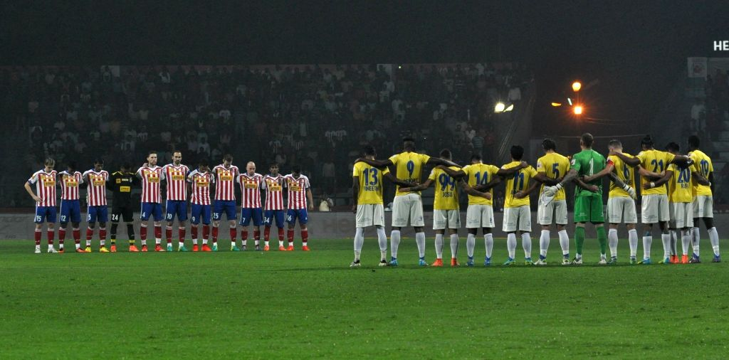 Atletico de Kolkata and Kerala Blasters FC players observe one-minute silence for the Brazil's Chapecoense football team players who died in a plane crash during an ISL match between ...