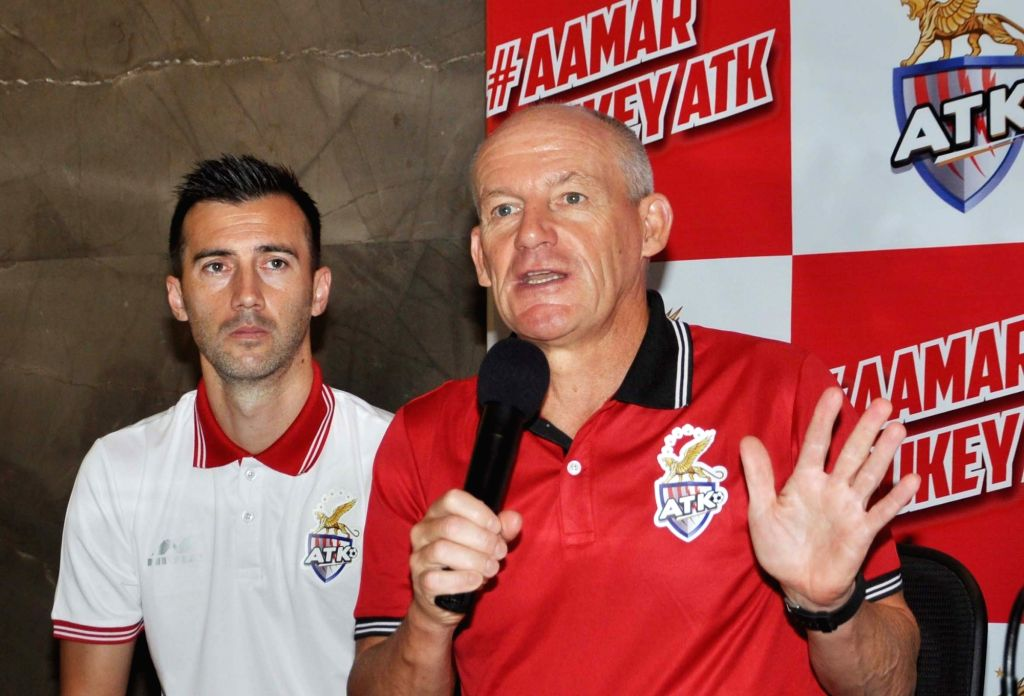Atletico de Kolkata (ATK) head coach  Steve Coppell addresses at the launch of the team's new jersey, along with ATK captain Manuel Lanzarote Bruno, in Kolkata on Sept 20, 2018. - Manuel Lanzarote Bruno