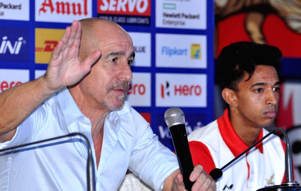 Atletico de Kolkata coach Antonio Lopez Habas addresses a pre-match press conference in Kolkata, on Nov 21, 2015. Also seen ATK player Sameehg Doutie.